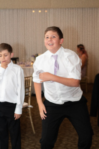 The Jr. Groomsman and the Ring Bearer dancing.